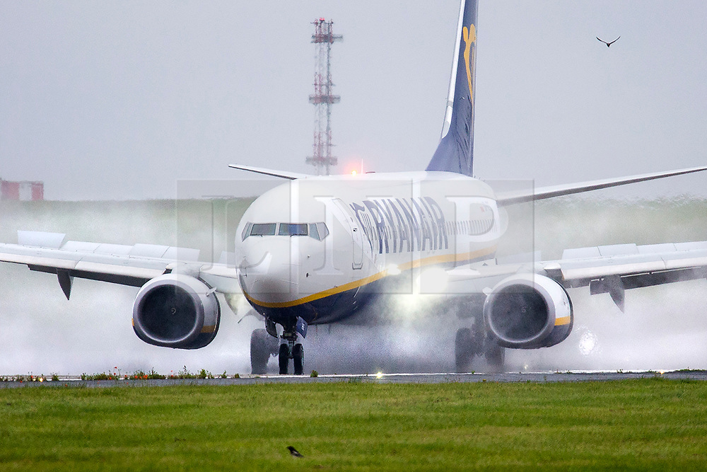 © Licensed to London News Pictures. 02/07/2020. Leeds UK. A Ryanair aircraft is engulfed in water as it lands in the rain at Leeds Bradford airport this morning. It is thought the Prime Minister is expected to give the green light for Britons to travel to 95 foreign destinations later today. The move could put holidays back on the agenda for some and it also signals the end of the UK's blanket quarantine policy on arrivals to the UK. Photo credit: Andrew McCaren/LNP