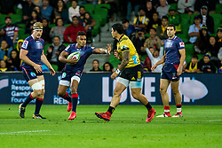 March 30, 2018 - Melbourne, VIC, U.S. - MELBOURNE, AUSTRALIA - MARCH 30 : Amanaki Mafi of the Melbourne Rebels deflects a hurricane player during Round 7 of the Super Rugby Series between the Melbourne Rebels and the Wellington Hurricanes on March 30, 2018, at AAMI Park in Melbourne, Australia. (Photo by Jason Heidrich/Icon Sportswire) (Credit Image: © Jason Heidrich/Icon SMI via ZUMA Press)