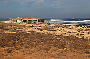 Beach fishing shack buildings near Majanicho on north coast of Fuerteventura, Canary Islands, Spain