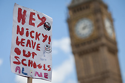 © Licensed to London News Pictures. 05/07/2016. London, UK. Protesters carry signs targeting Nicky Morgan MP, Secretary of State for Education, as thousands of school teachers march through central London while on strike. The strike, called by the National Union of Teachers (NUT), is in response to cuts to funding and issues with workload, pay and other conditions. Photo credit: Rob Pinney/LNP