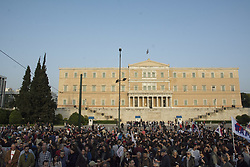April 17, 2018 - Athens, Greece - Protesters gathered outside the parliament hold banners and shout slogans against Trump, May and Macron. Thousands,members of the Greek Communist Party as well as other leftist parties marched to the American Embassy protesting over the recent US-led strikes on Syria. (Credit Image: © Nikolas Georgiou via ZUMA Wire)