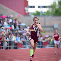 Rehoboth Lynx freshman Anna Huizinga, crosses the halfway point in the 800m race. Huizinga won the NMAA 2A Girls State Championship in Albuquerque on Friday.