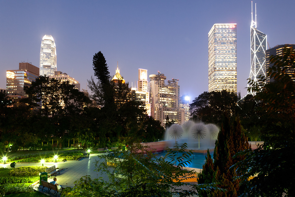Hong Kong, China, Asia - View of the Zoological and Botanical Gardens in Chung Wan (Central District), with skyline of skyscrapers in the background.