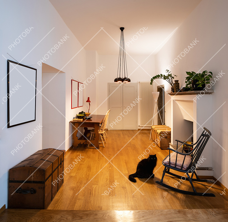 Office with rocking chair and parquet in the renovated apartment. Nobody inside
