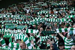 Celtic's fans celebrate winning the league after the Ladbrokes Scottish Premiership match at Celtic Park, Glasgow.