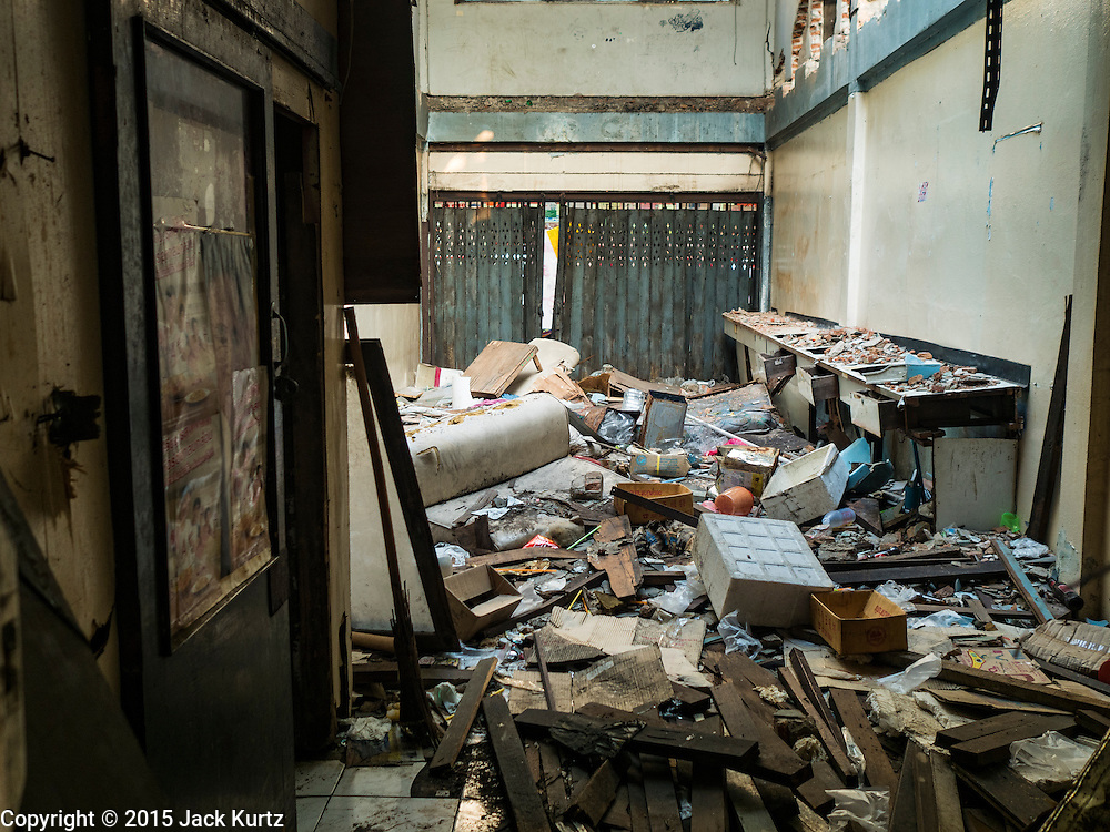 14 DECEMBER 2015 - BANGKOK, THAILAND:  An abandoned home in Bang Chak Market. The building is scheduled to be demolished in the next month. The market closes permanently on Dec 31, 2015. The Bang Chak Market serves the community around Sois 91-97 on Sukhumvit Road in the Bangkok suburbs. About half of the market has been torn down. Bangkok city authorities put up notices in late November that the market would be closed by January 1, 2016 and redevelopment would start shortly after that. Market vendors said condominiums are being built on the land.      PHOTO BY JACK KURTZ