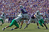 Marshall defensive tackle Bilal El-Amin (92) hits Kansas State quarterback Dylan Meier (9) as he releases the ball in the first half, at Bill Snyder Family Stadium in Manhattan, Kansas, September 16, 2006.  The Wildcats beat the Thundering Herd 23-7.