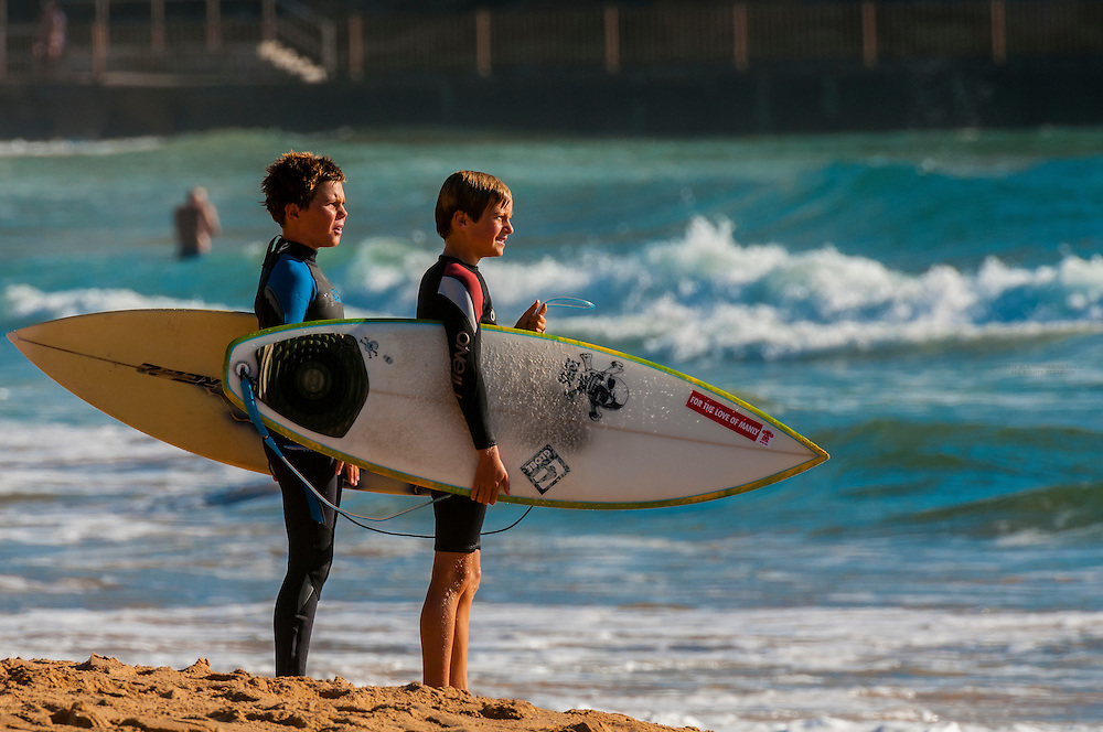 Young surfers, Manly Beach, Sydney, New South Wales, Australia.