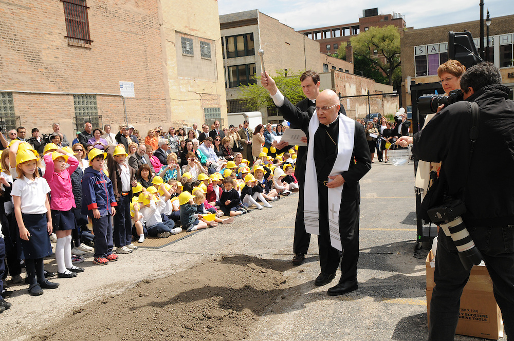 Archbishop Francis Cardinal George blesses the future site of the expanding  Old St. Mary's Catholic School in Chicago's South Loop neighborhood during a ground breaking ceremony.