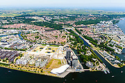 Nederland, Noord-Holland, Amsterdam-Noord, 29-06-2018; Buiksloterham,  Overhoeks, voormalig Shell Research-terrein. Huisvest nu onder andere filmmuseum EYE (EYE Film Instituut Nederland), de toren Overhoeks, de A'DAM Lookout toren, Tolhuistuin, Oeverpark. Ingang Noordhollandsch kanaal met Willem I-sluis.  Links vh kanaal Van der Pekbuurt, Disteldorp, Volewijck, Noorderpark, rechts IJplein en Vogelbuurt, Tuindopr Buiksloot.<br /> Overhoeks, a new city district on the IJ bank in Amsterdam-North.<br /> <br /> luchtfoto (toeslag op standard tarieven);<br /> aerial photo (additional fee required);<br /> copyright foto/photo Siebe Swart