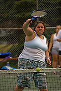 Mackenzie Wolfson plays tennis with her counterparts as part of a weight loss program at Camp Shane  in the Catskill Mountains, New York. (MacKenzie Wolfson is featured in the What I Eat: Around the World in 80 Diets.)  There are about 500 male and female campers housed in small cabins on shaded hillsides overlooking athletic fields, a small lake, and the camp's most important building, the cafeteria.