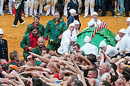 Doudou (Ducasse de Mons), Mons, Belgium (15 June 2014). The crowd attempts to pull hair from the tail of the 'dragon', during the ritual combat on the Grand Place. © Rudolf Abraham