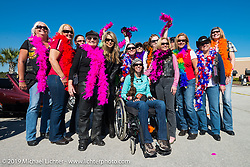 Mary Vida (in chair) with Karen Davidson and other friends  as the Women's MDA Fundraiser Ride arrives at Destination Daytona during Daytona Bike Week. FL, USA. March 11, 2014.  Photography ©2014 Michael Lichter.