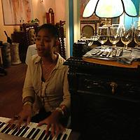 Central America, Cuba, Havana. Singer Sandy Stocker plays at Mama Ines in Old Havana.