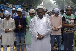 June 23, 2017 - Kolkata, West Bengal, India - Despite of heavy rain Muslim men gathers for prayers during the Jumat-Ul-Vida or the last Friday prayer of the holy fasting month of Ramadan on June 23, 2017 in Kolkata. (Credit Image: © Saikat Paul/Pacific Press via ZUMA Wire)