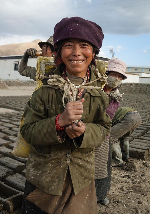 Brick makers in Lhaze, Tibet, China. Photo © robertvansluis.com