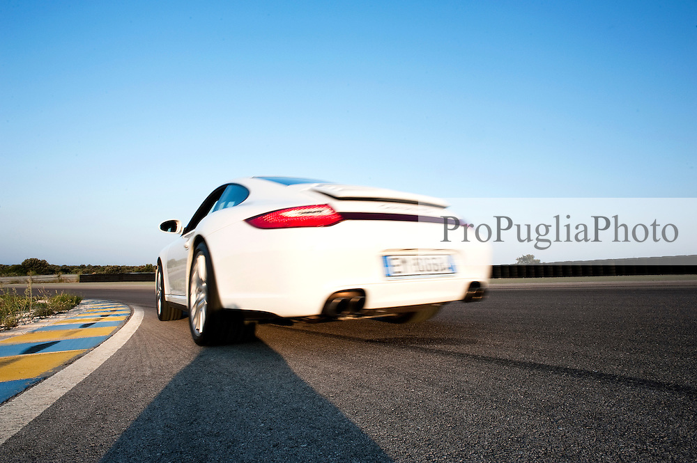 """19 August 2012.Photoreportage Nardò Techical Center Porsche Engineering ..NEWS ABOUT.Stuttgart/Nardò. In May 2012, the Porsche Engineering Group will be taking over responsibility for the Nardò Technical Center automotive proving ground in Apulia in southern Italy from Prototipo SpA. With more than 80 years experience in engineering services, the hundred per cent subsidiary of Dr. Ing. h.c. F. Porsche AG, Stuttgart, will be further optimising the test facilities and making them available to its clients for testing and trials purposes. Covering an area of more than 700 hectares, the test ground in the Province of Lecce comprises a 6.2 kilometre long handling circuit, a 12.5 kilometre long oval circuit and facilities for simulating different road surfaces and changeable weather conditions..""""The Nardò proving ground with its high-speed and vehicle handling circuit ideally complements our facilities in Weissach. With the systematic development of the company in Nardò as part of Strategy 2018, Porsche is proving to be a reliable employer and business partner in Apulia as well,"""" said Matthias Müller, President and CEO of Porsche AG..""""With its rich array of facilities, from dynamic surfaces to acoustic and off-road sections coupled with the numerous workshops, our clients can continue to make extensive use of Nardò for their vehicle trials in the future as well,"""" said Malte Radmann, CEO of Porsche Engineering. Thanks to the mild climate, the Nardò proving ground can be used throughout the year in three shifts around the clock, seven days a week..Together with the Porsche Development Centre in Weissach near Stuttgart, the Porsche Engineering Group has been offering Porsche's extensive development expertise as a service to its clients from the automotive industry and other sectors worldwide, from renting test rigs to developing complete vehicles.."""