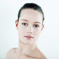 studio natural beauty portrait on isolated background of a young beautiful caucasian woman