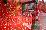 Red and white spotted window display theme in Selfridges, a collaboration between Louis Vuitton and Yakoi Kusama whose red campaign theme accompanies a life size model of the artist. Yayoi Kusama (1929) is a Japanese artist and writer. Throughout her career she has worked in a wide variety of media, including painting, collage, sculpture, performance art and environmental installations, most of which exhibit her thematic interest in psychedelic colors, repetition and pattern.