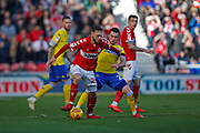 Middlesbrough midfielder Lewis Wing (26)  holds off  Leeds United midfielder Jack Harrison (22),  during the EFL Sky Bet Championship match between Middlesbrough and Leeds United at the Riverside Stadium, Middlesbrough, England on 9 February 2019.
