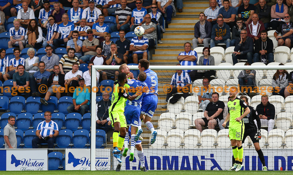 Players from both teams challenge for the same ball during the Sky Bet League 2 match between Colchester United and Exeter City at the Weston Homes Community Stadium in Colchester. September 3, 2016.<br /> Arron Gent / Telephoto Images<br /> +44 7967 642437