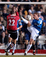 Photo: Glyn Thomas.<br />Birmingham City v Manchester United. Carling Cup.<br />20/12/2005.<br /> Birmingham's Nicky Butt (R) goes for the ball as John O'Shea takes evasive action.