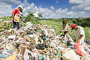 09 NOVEMBER 2004 - TAPACHULA, CHIAPAS, MEXICO: Children work in the municipal garbage dump in Tapachula, Chiapas, Mexico. About 130 people, the poorest of the poor in Tapachula, work in the dump picking through the garbage hoping to find tidbits they can use or sell to brokers who sit on the edge of the dump and resell the garbage. Most of the dump workers are Guatemalan migrants who crossed the border hoping, at one time, to get to the United States. Now they have settled for an existence on the very edge of Mexican society. PHOTO BY JACK KURTZ