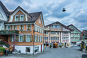 Frescoes decorate buildings in Appenzell village, in Switzerland, Europe. Appenzell Innerrhoden is Switzerland's most traditional and smallest-population canton (second smallest by area).