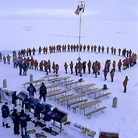 ARCTIC OCEAN. Tourists join hands around North Pole after cruise on Russian nuclear icebreaker Yamal.