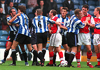 Fotball<br /> Norske spillere i England<br /> Foto: Colorsport/Digitalsport<br /> NORWAY ONLY<br /> <br /> Paolo Di Canio (Left) is held back by Petter Rudi after a clash with Arsenal defender Martin Keown (right). Sheffield Wednesday 1:0 Arsenal, 26/9/98.