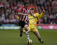 Fotball<br /> England 2004/2005<br /> Foto: SBI/Digitalsport<br /> NORWAY ONLY<br /> <br /> Southampton v Liverpool <br /> 22.01.2005<br /> <br /> David Prutton is tackled by Dietmar Hamann