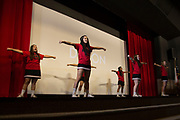 The Iraan High School cheerleaders take the stage during a pep rally in Iraan, Texas on December 14, 2016. (Cooper Neill for The New York Times)