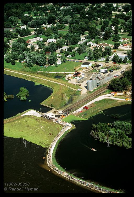 Aerial:folks sandbag levee on 8/4/93 as Mississippi nears top and threatens Prairie du Rocher. Illinois