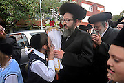 When a new Sefer Torah (five books of Moses) is completed after years of work it is carried in a big community parade to synagogue. Rabbi's and leaders young and old from the Ashkenazi Nitra group take it turns to carry the decorated scrolls to their Shul on Clapton Common, Stamford Hill. Members of the community touch and kiss the scrolls as they pass.