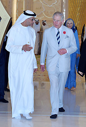 The Prince of Wales and the Duchess of Cornwall (at rear) visit Sheikh Zayed Grand Mosque in Abu Dhabi, United Arab Emirates, during the royal tour of the Middle East. Visitors to the mosque must remove their footwear, and Charles walked round in black socks while his wife went barefoot.