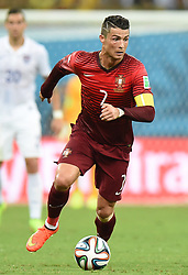MANAUS, June 22, 2014  Portugal's Cristiano Ronaldo runs with the ball during a Group G match between U.S. and Portugal of 2014 FIFA World Cup at the Arena Amazonia Stadium in Manaus, Brazil, June 22, 2014.(Xinhua/Liu Dawei) (Credit Image: © Xinhua via ZUMA Wire)