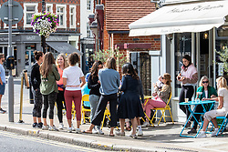 "© Licensed to London News Pictures. 12/09/2020. London, UK. Groups of people enjoy a coffee and cake in the sunshine in Wimbledon Village in South West London this afternoon before the ""Rule of 6"" comes into force on Monday as weather experts announce a 6 day mini heatwave in the South East of England this week with highs in excess of 29c. Prime Minister Boris Johnson is already under pressure after he announced on Friday that gatherings of more than six people will be banned from Monday in the hope of reducing the coronavirus R number. The Rule of Six as it is known, has already become unpopular with MPs and large families. Photo credit: Alex Lentati/LNP"