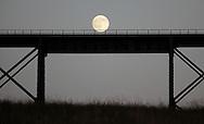 Salisbury Mills, New York - An almost full moon rises behind the Moodna Viaduct railroad trestle on Nov. 20, 2010.