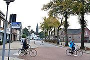 Nederland, Millingen aan de Rijn, 1-10-2014Hoofdstraat in het centrum van Millingen, de Heerbaan. Gemeente Millingen zal bestuurlijk samengaan met Ubbergen en Groesbeek. Het is een artikel 12 gemeente, te klein om zichzelf te bedruipen en heeft grote bestuurlijke problemen. Centrum van de Millingerwaard.Foto: Flip Franssen/Hollandse Hoogte