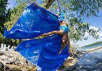 Erin Lovett Sherman performs on aerial silks on Lake Winnipesaukee during her artist in residence with Sandy Island Family Camp.    (Karen Bobotas/for the Laconia Daily Sun)