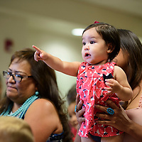 Marleigh St. Clair, 14 months, is held by up her mom Tanya Marshall at story time with Mayor Jackie McKinney at the Octavia Fellin Public Library Children's Branch, Wednesday August 15, 2018.