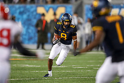 Sep 8, 2018; Morgantown, WV, USA; West Virginia Mountaineers wide receiver Marcus Simms (8) runs after a catch during the third quarter against the Youngstown State Penguins at Mountaineer Field at Milan Puskar Stadium. Mandatory Credit: Ben Queen-USA TODAY Sports