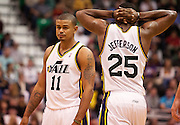 Jazz guard Earl Watson (11) and center Al Jefferson (25) look dejected after a series of turnovers during the first half of the NBA basketball game between the Utah Jazz and the Golden State Warriors at Energy Solutions Arena, Wednesday, Dec. 26, 2012.