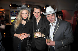 Left to right, YULIA DEMETKOVA, SIMON AMBROSE and JAMES MAX at a party to celebrate the opening of Barts, Sloane Ave, London on 26th February 2009.