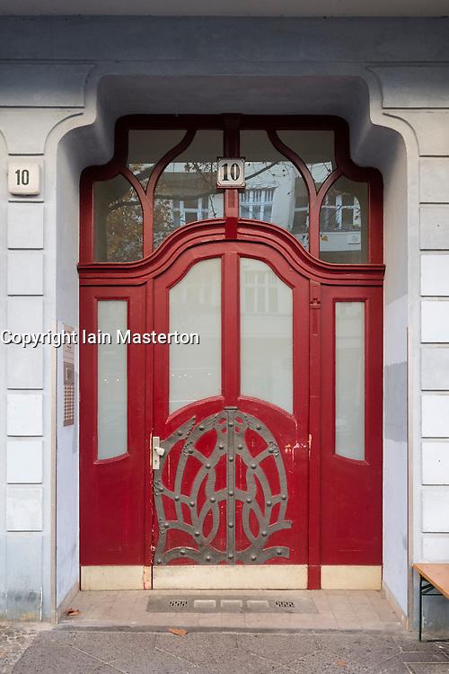 Ornate door to apartment building on historic Hufelandstrasse, in gentrified Prenzlauer Berg, Berlin, Germany