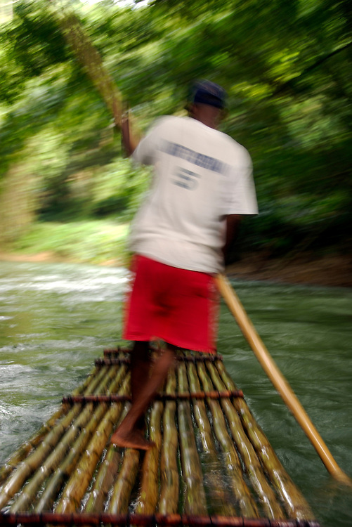 Rafting on the martha Brae River in Jamaica. Rafts made from Bamboo and are 30 foot long and are operated by experienced Captains. This is a very popular tourist attraction in Jamaica, The attraction is twenty five miles from Montego Bay and 40 miles from Ocho Rios.