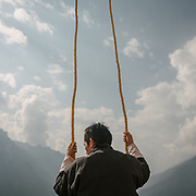 Man holding ropes that hold the Thongdrel. Rolling and packing of the Thongdrel. A Thongdrel is a large appliqué religious image normally only unveiled during tsechus, the main religious festivals in Bhutan. They are the largest form of thangka paintings in the tradition of Tibetan Buddhism. The Tshechu of the Gasa monastery on the road leading to Laya. Tshechu are annual religious Bhutanese festivals held in each district on the tenth day of a month of the lunar Tibetan calendar. Tshechus are large social gatherings, which perform the function of social bonding among people of remote and spread-out villages.