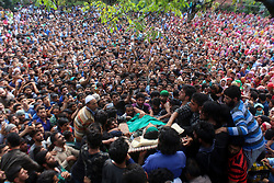 August 3, 2017 - Kulgam, Jammu and Kashmir, India - (EDITORS NOTE: Image depicts death) Kashmiri Villagers carry the dead body of Slain kashmiri Rebel Aaquib Hamid Itoo during the funeral at Gopalpora village of Kulgam District, 80 Km from Srinagar. Itoo was killed along with another associate Suhail Ah in a gunfight with forces in Kulgam. (Credit Image: © Muneeb Ul Islam/Pacific Press via ZUMA Wire)