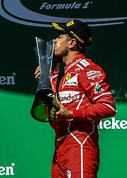 """SP - FÃ""""RMULA 1/GP DO BRASIL/VETTEL - POLÍTICA - O piloto alemão Sebastian Vettel, da Ferrari, comemora após vencer o Grande Prêmio do   Brasil de Fórmula 1, no Autódromo de Interlagos, na zona sul de São Paulo, na tarde deste   domingo (12).   12/11/2017 - Foto: RAFAEL ARBEX/ESTADÃO CONTEÚDO (Credit Image: © Agencia Estado/Xinhua via ZUMA Wire)"""