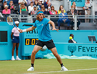 Tennis - 2019 Queen's Club Fever-Tree Championships - Day Three, Wednesday<br /> <br /> Men's Singles, First Round: Stefanos Tsitsipas (GRC) Vs. Kyle Edmund (GBR)<br /> <br /> Stefanos Tsitsipas (GRC) opens his frame as he prepares to strike the forehand on Centre Court.<br />  <br /> COLORSPORT/DANIEL BEARHAM